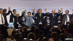 A standing ovation ends the negotiations in Paris. (Photo: UNFCCC)