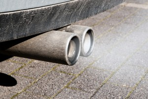 dirty dual exhaust pipes of a car