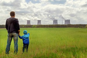 Pollution. Environmental problem. Father, son looking on emissions of plant.