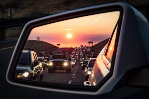 Traffic in the rearview mirror at sunrise