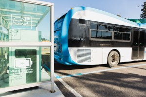 Electric bus is charging on a city street