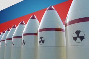 Nuclear missiles and Russian flag in background. 3D rendered illustration.