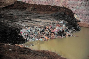 The Akhshtyr landfill for Sochi Olympic construction trash in the middle of a , in the middle of a water protection zone where dumping is banned. Environmental Watch of the North Caucasus
