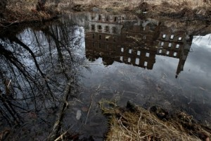 A reflection of Mayak's abandoned caisson plant on the river Techa. (Courtesy of Denis Sinyakov/ echo.msk.ru