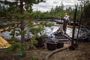 Greenpeace volunteers Anna Kopytova (Russia) and Emma Eineskog (Sweden) take part in oil spill clean up operation in a forest outside Usinsk in the Komi Republic