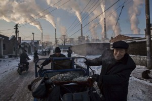 Daily Life, 1st prize singles, World Press Photo Awards (Kevin Frayer - China's Coal Addiction)Chinese men pull a tricycle in a neighborhood next to a coal-fired power plant in Shanxi, China, November 26, 2015. A history of heavy dependence on burning coal for energy has made China the source of nearly a third of the world's total carbon dioxide (CO2) emissions, the toxic pollutants widely cited by scientists and environmentalists as the primary cause of global warming.  REUTERS/Kevin Frayer via WPP        EDITORIAL USE ONLY. NO RESALES. NO ARCHIVE